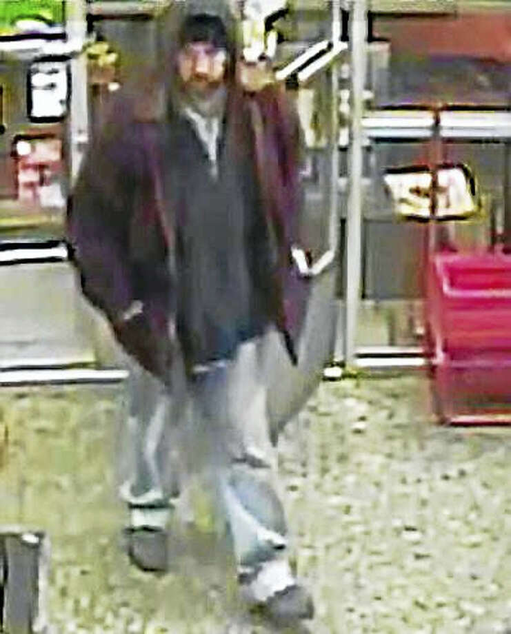 Police are asking the public to help them find the man in the red jacket who allegedly pushed a clerk Wednesday, Jan. 18, 2017, during a robbery attempt at Krauszer's, 111 Elm St. The clerk suffered a minor hand injury. Photo: Courtesy Of West Haven Police Department