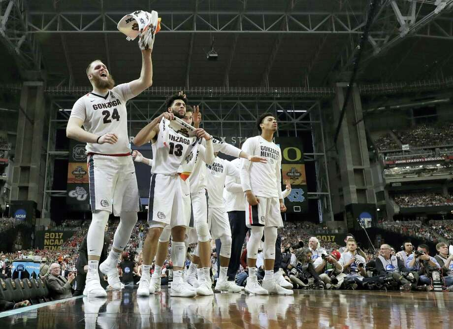 Gonzaga center Przemek Karnowski (24) celebrates with teammates on the bench during the second half against South Carolina on Saturday. Photo: David J. Phillip — The Associated Press   / Copyright 2017 The Associated Press. All rights reserved.