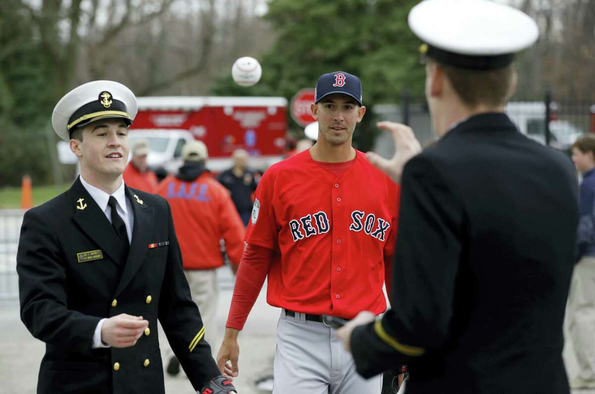 Red Sox pitcher Rick Porcello, center, plays catch with a pair of Midshipmen before Saturday's exhibition game.