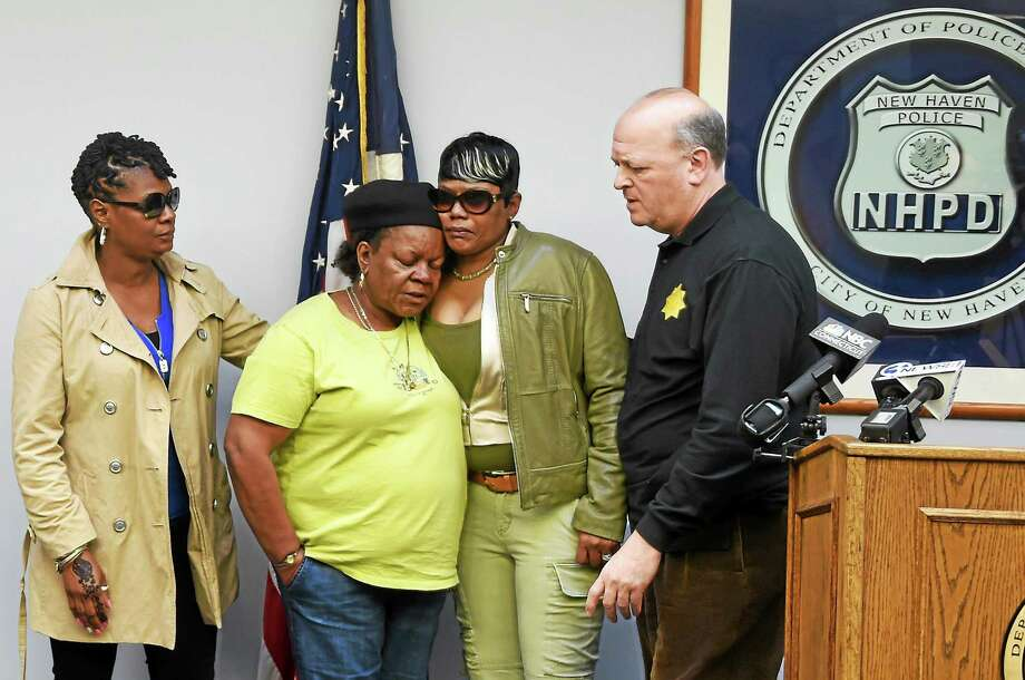 "In this file photo, then-New Haven Police Chief Dean Esserman, far right, with the family of slaying victim Thomas ""TJ"" Mozell during a press conference at the New Haven Police Department in March 2014 announcing the arrest of Vincente ""Guns"" Ayala, who was charged with murder. From left are Mozell's cousins Arlette Gray and Barbara Fair and mother, Kimberly Mozell, with Esserman. Photo: Peter Hvizdak — New Haven Register   / ©2015 Peter Hvizdak"