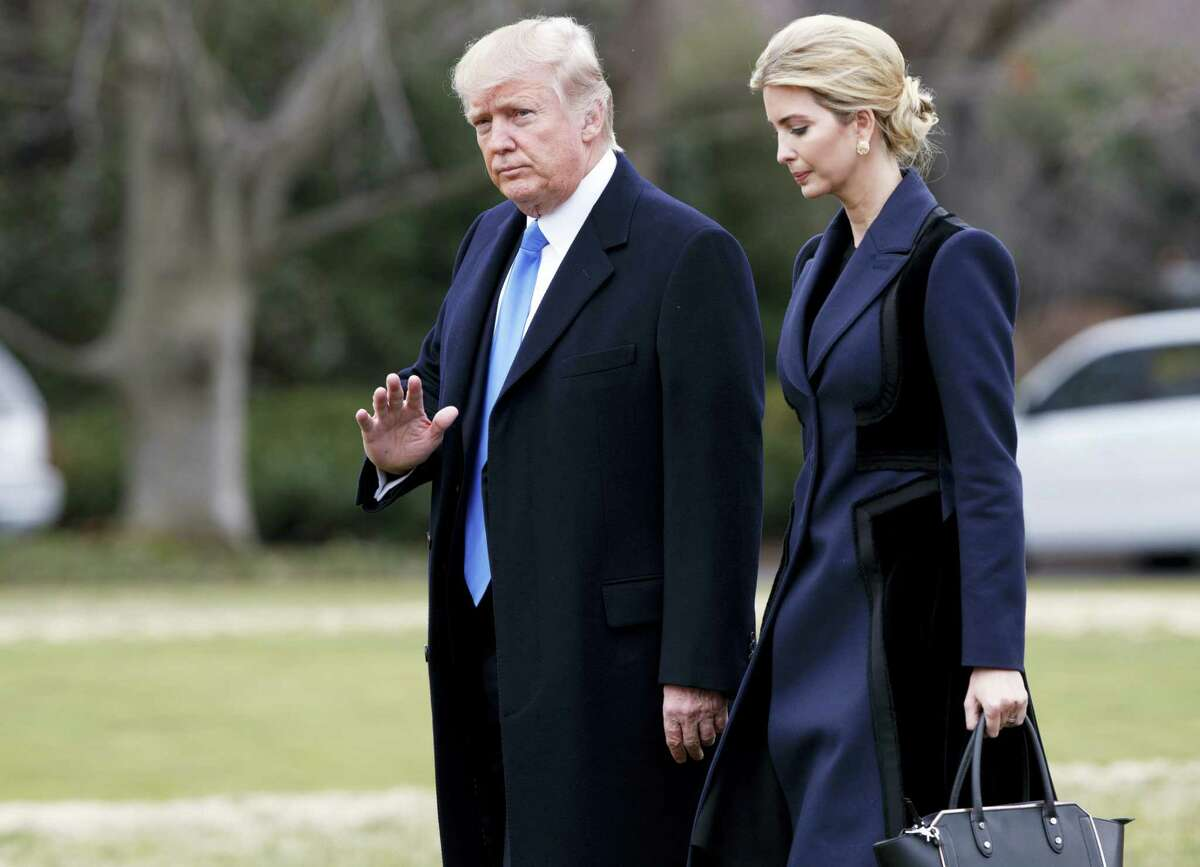 President Donald Trump, accompanied by his daughter Ivanka, waves as they walk to board Marine One on the South Lawn of the White House in Washington.
