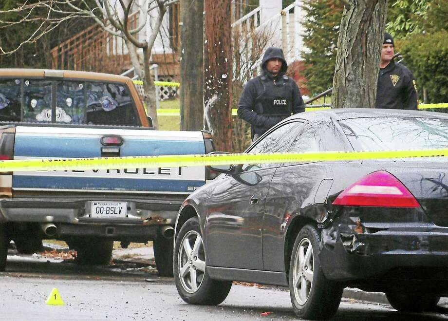 New Haven police are investigating after a man was shot late Tuesday morning on Winthrop Avenue. The man was taken to the hospital with a wound to his abdomen. Photo: Wes Duplantier — New Haven Register