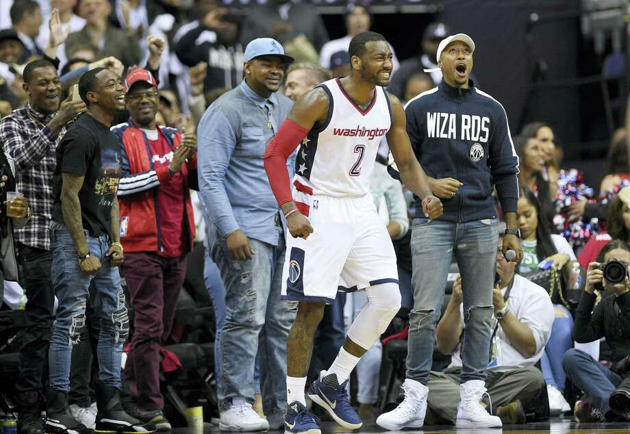 Wizards guard John Wall (2) reacts during the second half Sunday. Photo: Nick Wass — The Associated Press   / FR67404 AP