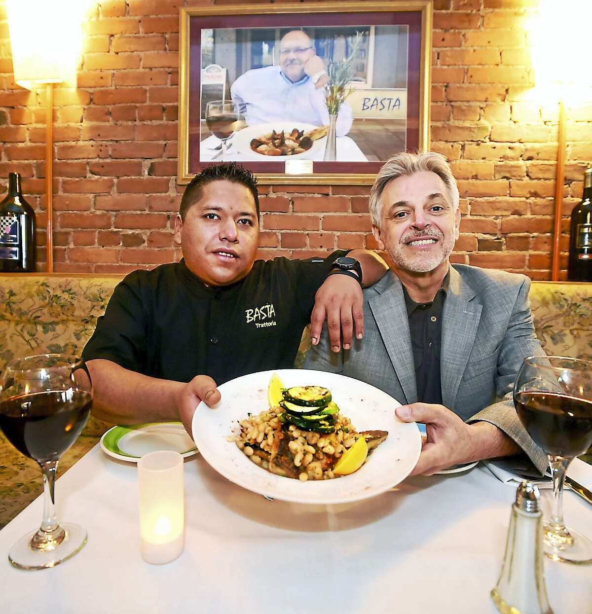 Chef Eduardo Saldana Pena, left, and Nino Ribeiro, co-owners of Basta Trattoria, with branzino Amalfi, a pan-seared mild white fish with extra virgin olive oil, lemon and roasted garlic over truffled organic white beans and roasted zucchini.