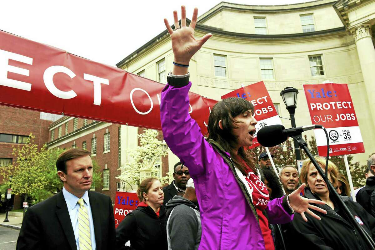 Laurie Kennington, UNITE HERE Local 34 president, speaks to Yale University workers in front of the Yale Medical School on Cedar Street in New Haven during a rally May 5. U.S. Sen. Chris Murphy, D-Conn., is at left.
