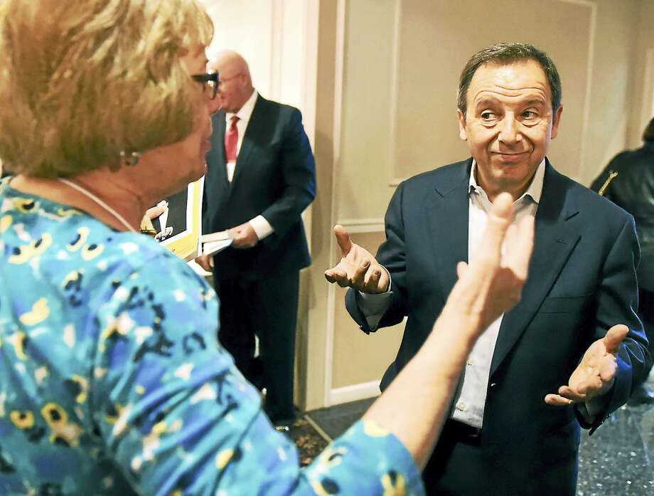 "Journalist Ron Suskind, who wrote ""Life, Animated,"" about his autistic son, speaks with attendees after giving a talk during the Clifford Beers Clinic Builders of Hope breakfast in North Haven Wednesday, March 29, 2017 Photo: Peter Hvizdak - New Haven Register   / ©2017 Peter Hvizdak"