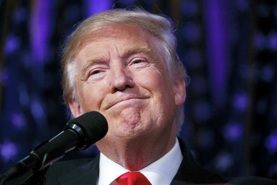 President-elect Donald Trump smiles as he arrives to speak at an election night rally in New York. Photo: Evan Vucci — AP File Photo / Copyright 2016 The Associated Press. All rights reserved.