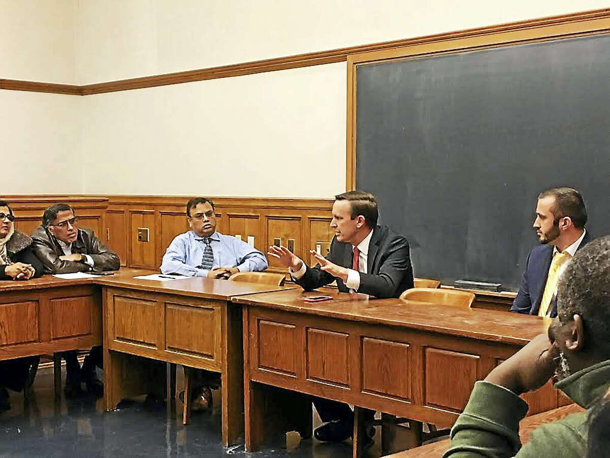 U.S. Sen. Chris Murphy, center, speaks Tuesday with Connecticut Muslim leaders at the Yale Law School.