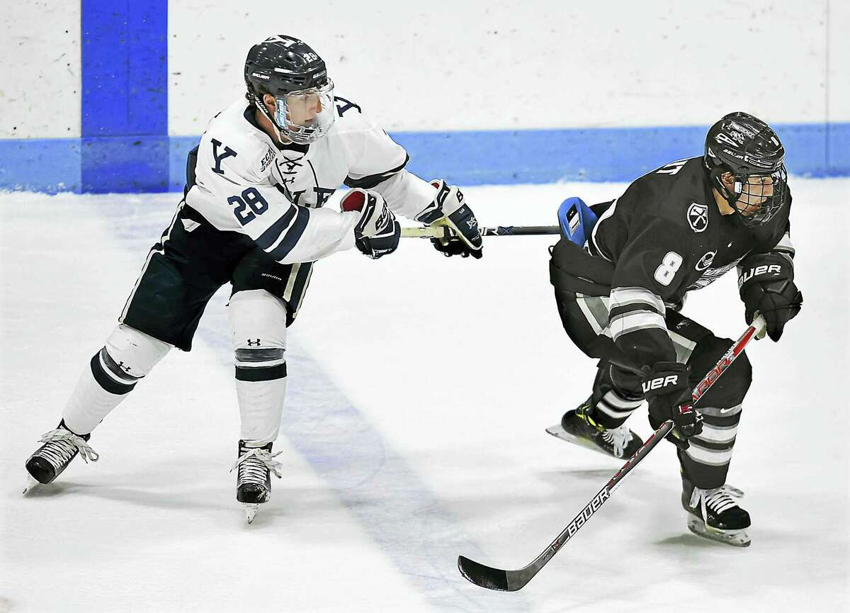 Yale's Ryan Hitchock, left, is likely done for the season after suffering a broken leg during Saturday's tie with St. Lawrence.