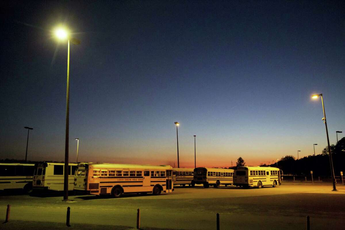 ADVANCE FOR USE MONDAY, MAY 8, 2017 AND THEREAFTER-This Tuesday, Jan. 31, 2017 photo shows school buses parked at Estill Middle School, where a sexual assault case was reported in 2013, in Estill, S.C. Most parents have no choice but to send their children to the public schools. More than 90 percent of students at Estill Middle School receive free or reduced lunch. (AP Photo/David Goldman)