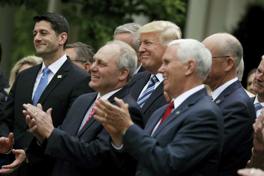 From left, House Speaker Paul Ryan of Wis., House Majority Whip Steve Scalise of La., President Donald Trump, and Vice President Mike Pence applaud in the Rose Garden of the White House in Washington after the House pushed through a health care bill. Photo: Evan Vucci — The Associated Press   / Copyright 2017 The Associated Press. All rights reserved.