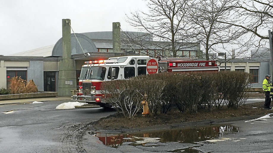 Woodbridge firefighters arrive at the JCC campus on Amity Road late Wednesday morning to investigate a threat. Photo: Wes Duplantier — New Haven Register