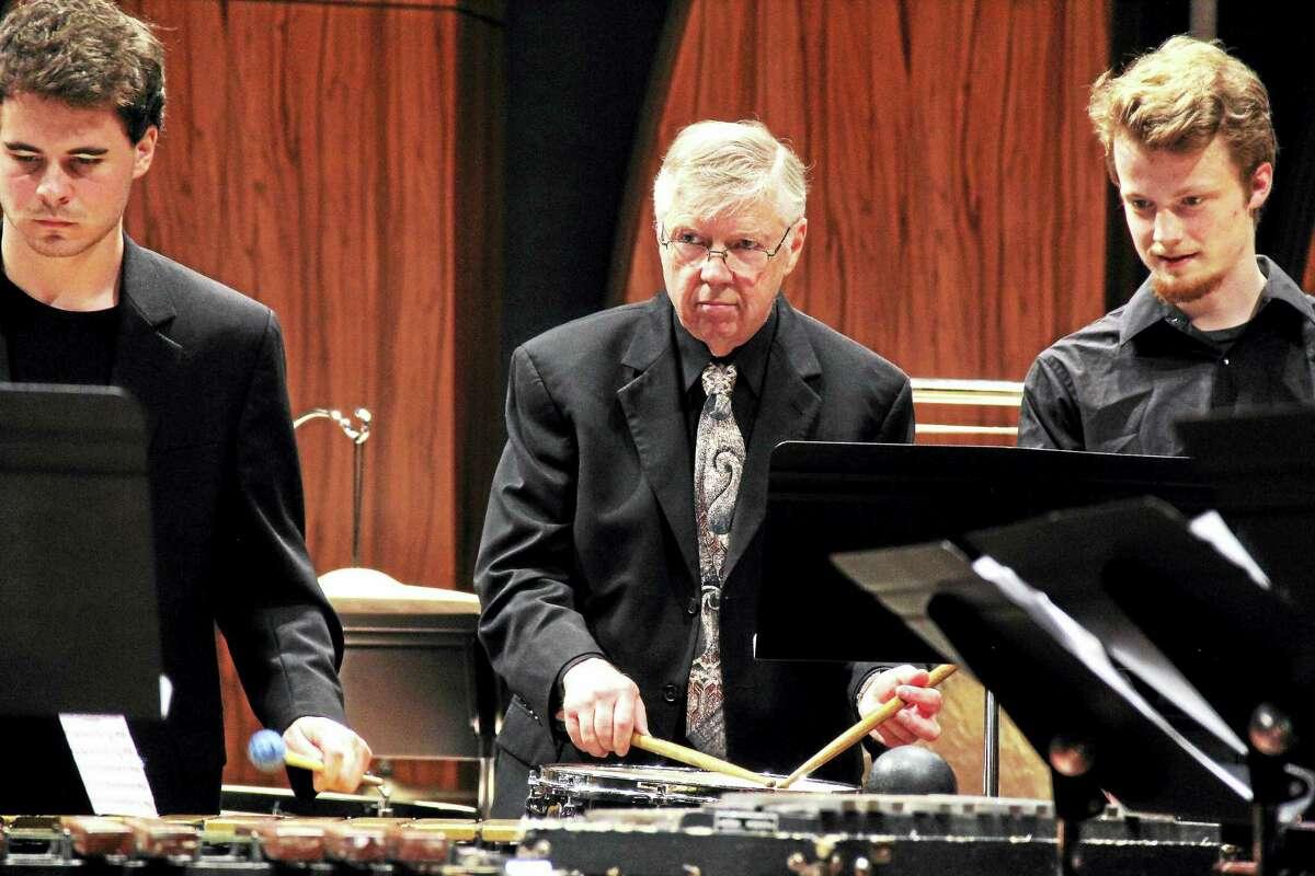 Percussion Director David Smith conducts.