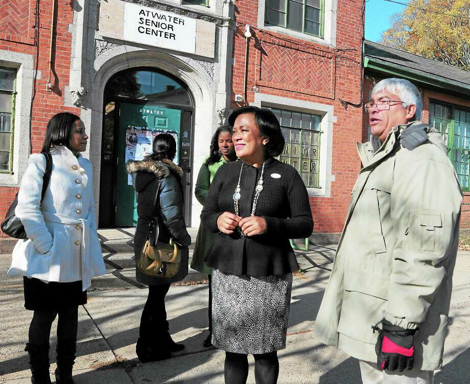 In this file photo New Haven Alder Santiago Berrios-Bones, far right, campaigns in front of the Atwater Senior Center in New Haven with Mayor Toni Harp, who was then seeking election. Photo: Peter Hvizdak — New Haven Register File Photo   / ©Peter Hvizdak /  New Haven Register