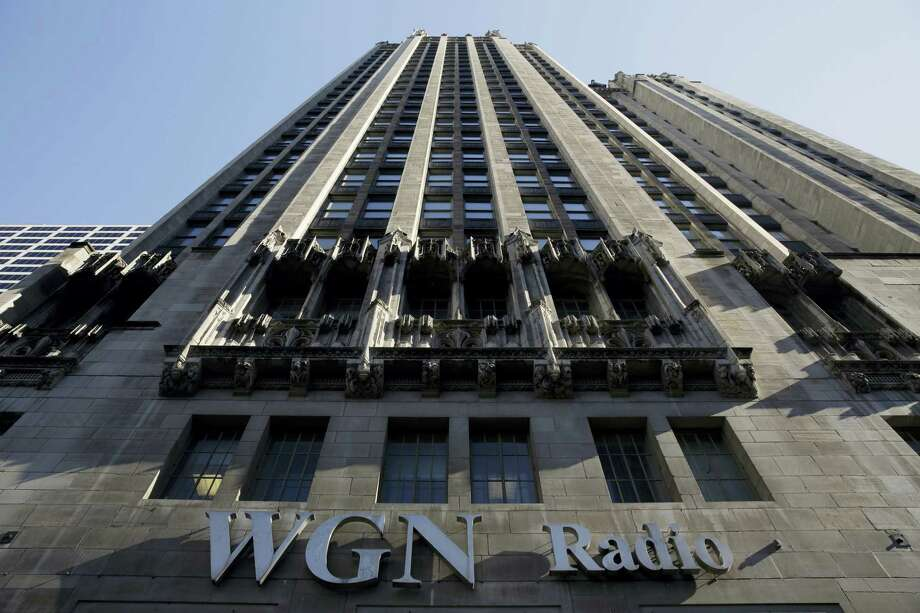 The WGN Radio sign appears on the side of Tribune Tower on May 1, 2017, in downtown Chicago. Tribune owns or operates 42 local TV stations across the nation, including WPIX in New York, KTLA in Los Angeles and WGN in Chicago. Photo: AP Photo — Kiichiro Sato   / Copyright 2017 The Associated Press. All rights reserved.