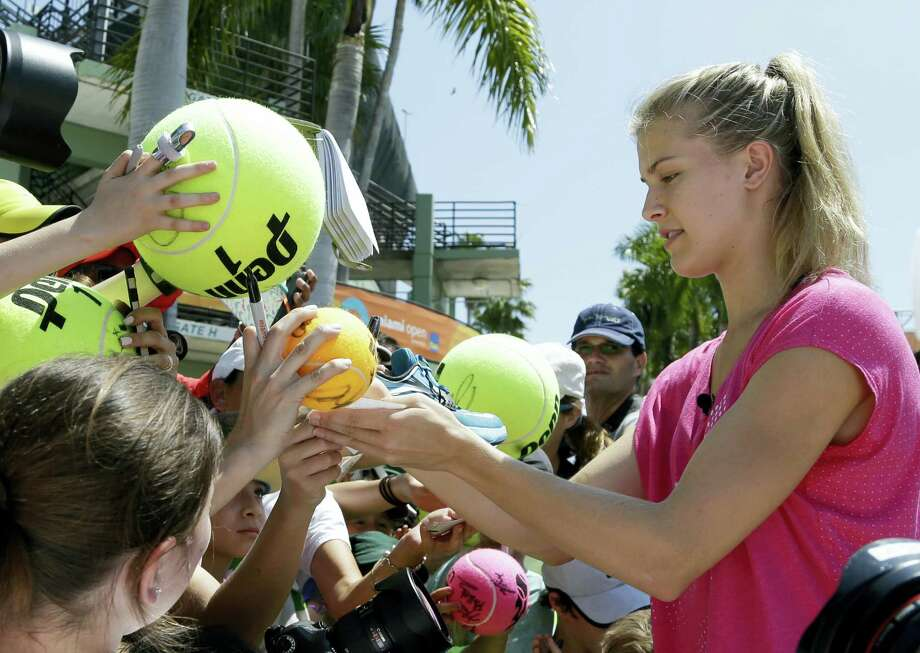 Tennis star Genie Bouchard signs autographs for fans. Photo: The Associated Press File Photo   / Copyright 2017 The Associated Press. All rights reserved.