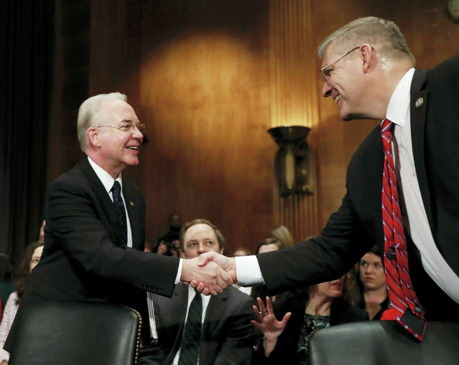 Health and Human Services Secretary-designate, Rep. Tom Price, R-Ga., left, is greeted on Capitol Hill in Washington, Wednesday, Jan. 18, 2017, by Rep. Barry Loudermilk, R-Ga., prior to testifying at this confirmation hearing before the Senate Health, Education, Labor and Pensions Committee. Photo: Carolyn Kaster — AP Photo   / Copyright 2017 The Associated Press. All rights reserved.