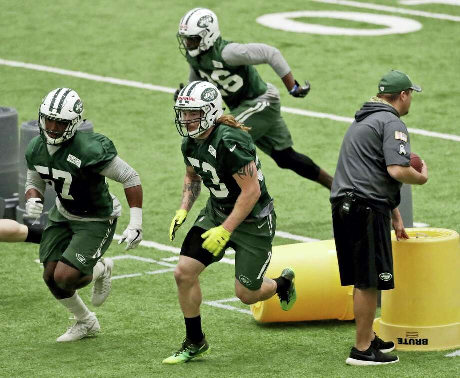 The Jets' Dylan Donahue, center, runs a drill during rookie minicamp Friday in Florham Park, N.J. Photo: Julio Cortez — The Associated Press   / Copyright 2017 The Associated Press. All rights reserved.
