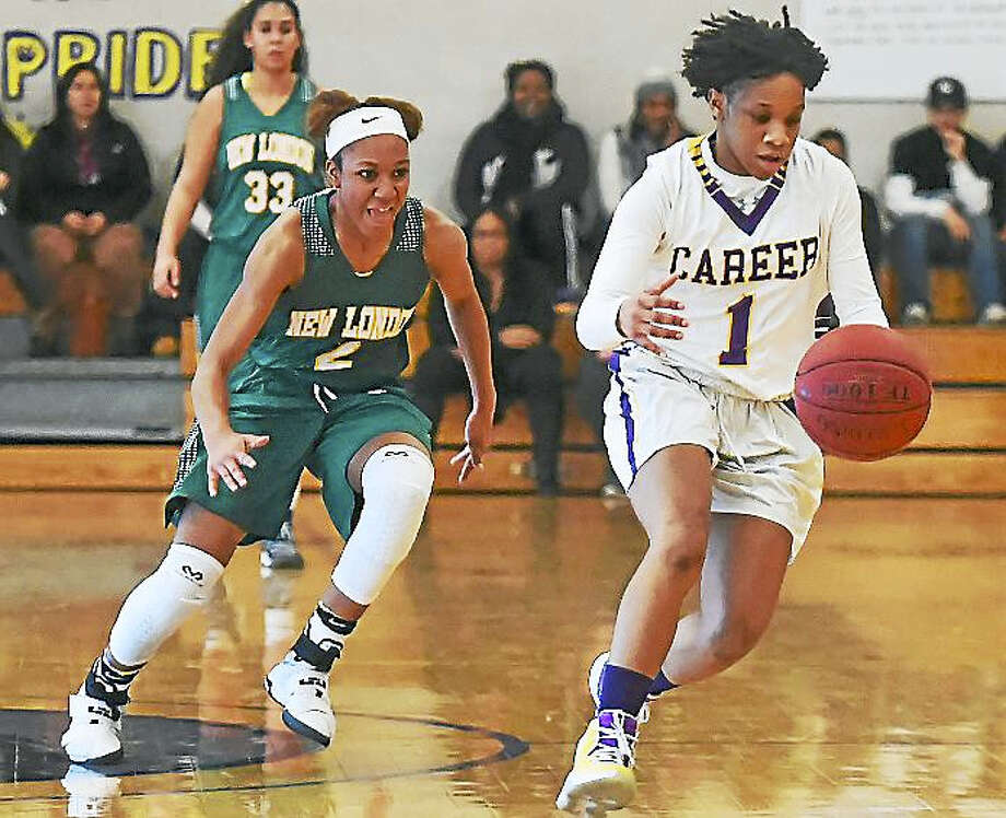 Career junior point guard Ky'Jae Hargrove grabs a loose ball as New London junior guard Rosalee Nicholson defends in a 49-43 win for the Panthers, in overtime at Career High School in New Haven. Photo: Catherine Avalone — New Haven Register