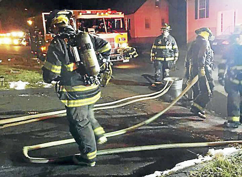 Crews battled a basement fire early Monday in a home on Gentile Place in Branford. The fire did significant damage and displaced three people. Photo: Photo Courtesy Of The Branford Fire Department