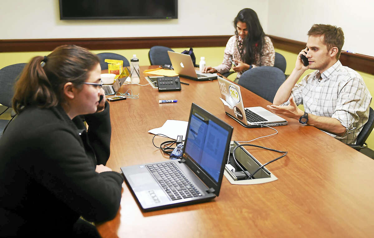 Frank H. Netter MD School of Medicine at Quinnipiac University Medical students Kristin Zozulin, left, Vithya Thambiaiyah, center, and Michael Smith gathered at the school with other students Wednesday afternoon, January 18, 2017 to place telephone calls to U.S. Senators to urge them to oppose plans to repeal the Affordable Care Act. Zozulin said the students will target moderate Republicans and U.S. Senators in states that make a difference in a vote for repeal.