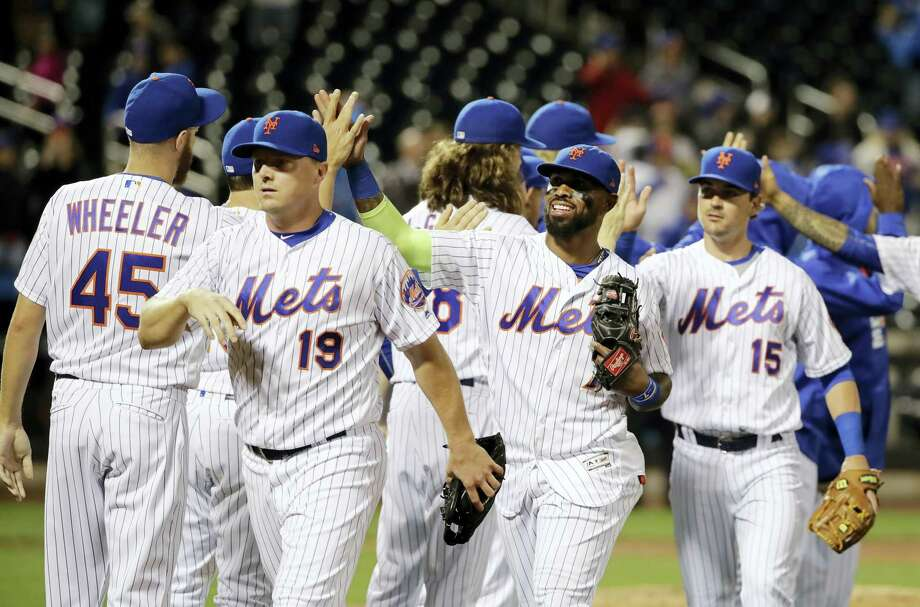 Members of the Mets celebrate their win over the Marlins on Saturday. Photo: Frank Franklin II — The Associated Press   / Copyright 2017 The Associated Press. All rights reserved.