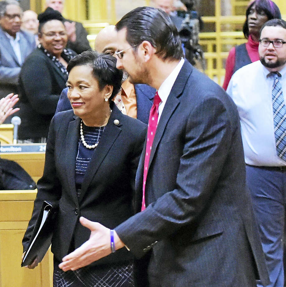 State Rep. and city Alder Alphonse Paolillo Jr. and others escort New Haven Mayor Toni N. Harp into Aldermanic Chambers before Harp's State of the City address Monday. Photo: Peter Hvizdak — New Haven Register   / ©2017 Peter Hvizdak