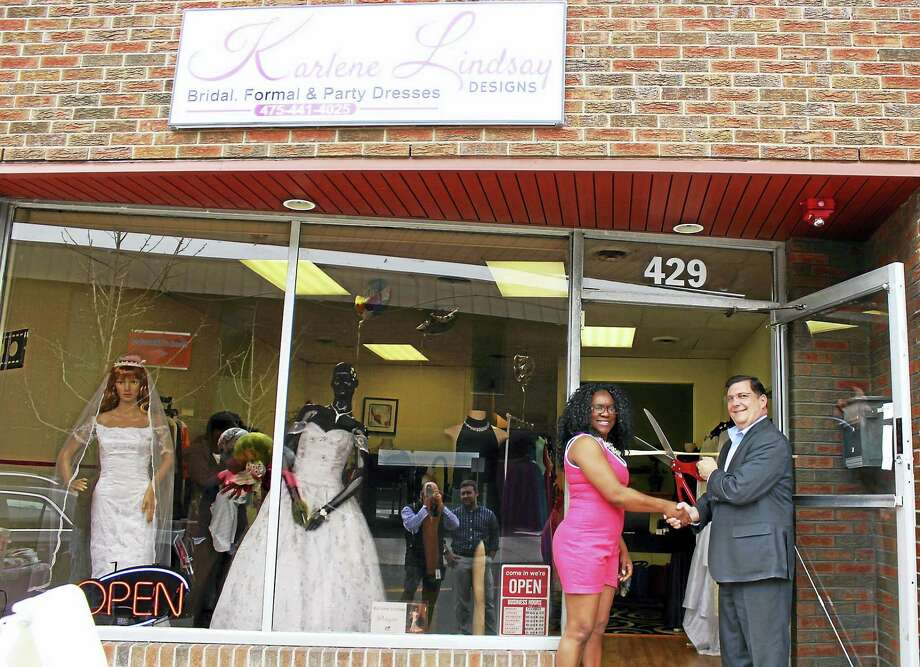 BRIDAL SHOP OPENS DOWNTOWN: West Haven Mayor Edward M. O'Brien cuts the ceremonial ribbon with Karlene Lindsay-Worrell, CEO and designer of Karlene Lindsay Designs, to celebrate the custom bridal shop's grand opening at 429 Campbell Ave. Karlene Lindsay Designs, originally established online in 2012, makes high-quality wedding, formal and party dresses for all sizes at affordable prices. The downtown shop is open 10 a.m.-8 p.m. weekdays and Saturdays, noon-4 p.m. Sundays. For an appointment, call 475-441-4025. Photo: CONTRIBUTED PHOTO — MICHAEL P. WALSH/CITY PHOTO