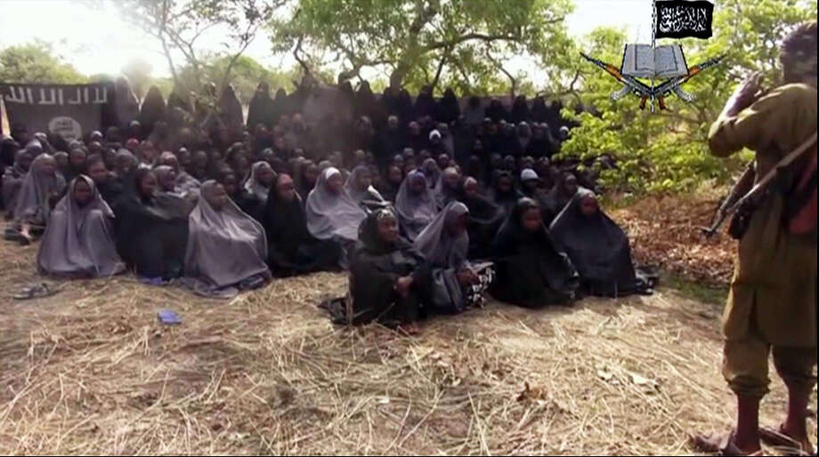 This Monday, May 12, 2014 file image taken from video by Nigeria's Islamic extremist network, shows the alleged missing girls abducted from the northeastern town of Chibok. An unknown number of girls kidnapped from their Nigerian boarding school by jihadists three years ago have been released, a government official said Saturday, May 6, 2017. Family members said they were awaiting names and other information before celebrating. Photo: AP Photo — File   / Extremist Video