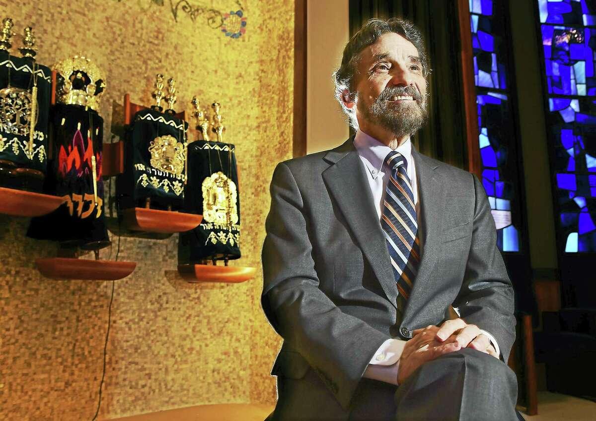 Rabbi Herbert Brockman announces his retirement from Congregation Mishkan Israel in Hamden. Wednesday.