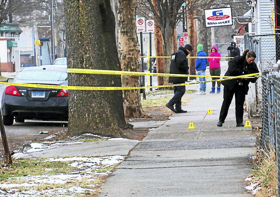New Haven police were investigating Tuesday after someone was shot on Ferry Street near Fox Street. Investigators were looking for a black crossover style vehicle that was seen in the area. Photo: Wes Duplantier — New Haven Register