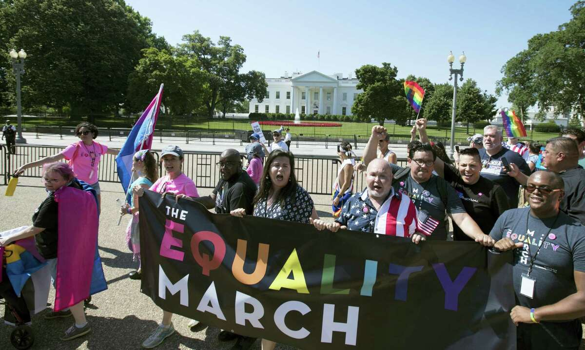 Equality March for Unity and Pride participants march past the White House in Washington, Sunday, June 11, 2017. (AP Photo/Carolyn Kaster)