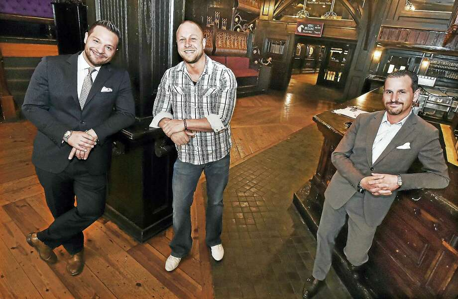 """John """"Johnny Mac"""" Mocadlo, at left, and Gregory Maloney, center, are co-owners of a new bar and nightclub, Vanity Bar, which is scheduled to open in September in the former Russian Lady at 144 Temple St. in New Haven. At right is the property owner, Christopher S. Nicotra of Olympia Properties. Photo: Catherine Avalone / Hearst Connecticut Media   / Catherine Avalone/New Haven Register"""