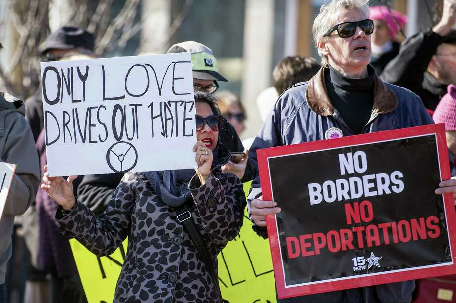 Sabita Manian, left, and her husband Brad Bullock hold signs and protest during a march against President Trump's immigration policies on Feb. 5, 2017 in Lynchburg, Va. Photo: Jay Westcott/The News & Advance Via AP   / The News & Advance