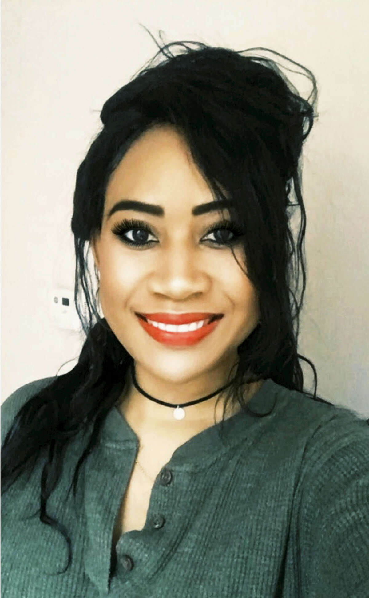 In this photo provided by Palesa Matinde, she is shown in a selfie. Matinee, a University of Michigan graduate said she was denied service by a Comerica Park waitress and ballpark ball manager who refused to recognize her U.S. government-issued green card as proof of age while attending a Detroit Tigers baseball game in Detroit.
