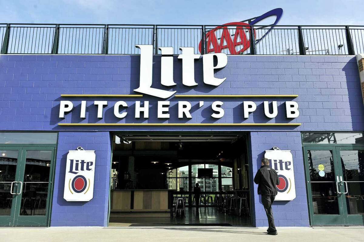 In this May file photo, a man walks into Pitcher's Pub inside Comerica Park in Detroit.