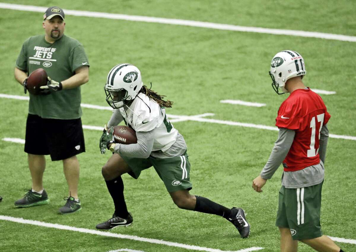 Khiry Robinson, center, runs with the ball during the Jets' rookie minicamp Friday in Florham Park, N.J.