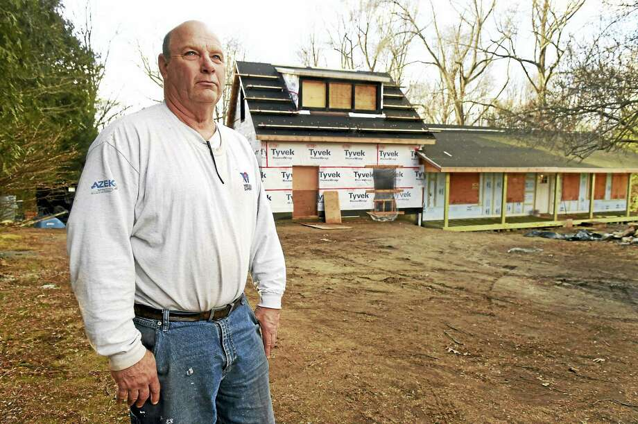 Peter Whaley is trying to rehabilitate a house in Shelton, rear in photo, after tragic events. Photo: Peter Hvizdak — New Haven Register   / ©2017 Peter Hvizdak