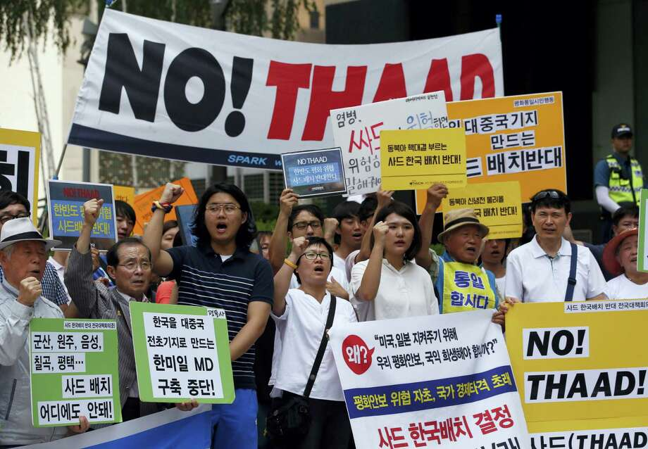 South Koreans shout slogans during a rally to denounce deploying the Terminal High-Altitude Area Defense, or THAAD, near U.S. Embassy in Seoul, South Korea. Photo: Lee Jin-man — The Associated Press   / Copyright 2016 The Associated Press. All rights reserved. This material may not be published, broadcast, rewritten or redistribu