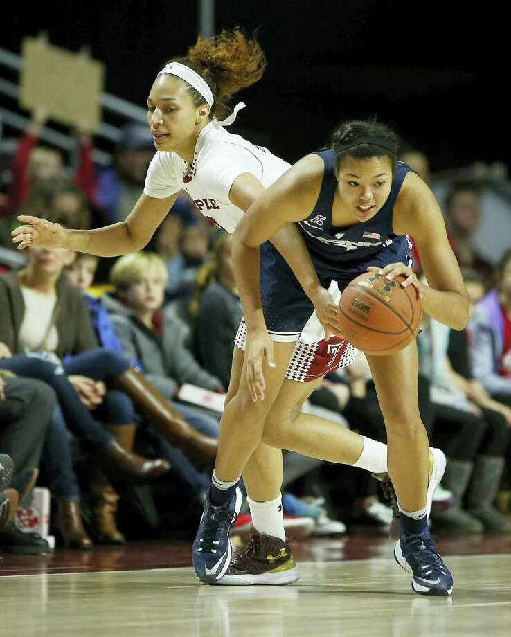 UConn forward Napheesa Collier steals the basketball from Temple forward Ruth Sherrill during Wednesday's game. Photo: Yong Kim — The Philadelphia Inquirer Via AP   / The Philadelphia Inquirer