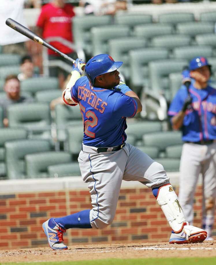 Mets left fielder Yoenis Cespedes follows through on his grand slam in the ninth inning Saturday against the Braves. Photo: John Bazemore — The Associated Press   / Copyright 2017 The Associated Press. All rights reserved.