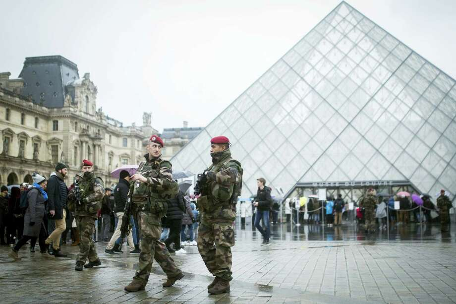 """French soldiers patrol in the courtyard of the Louvre museum in Paris, Saturday, Feb. 4, 2017.  The Louvre in Paris reopened to the public Saturday morning, less than 24-hours after a machete-wielding assailant shouting """"Allahu Akbar!"""" was shot by soldiers, in what officials described as a suspected terror attack. Photo: AP Photo/Kamil Zihnioglu    / Copyright 2017 The Associated Press. All rights reserved."""