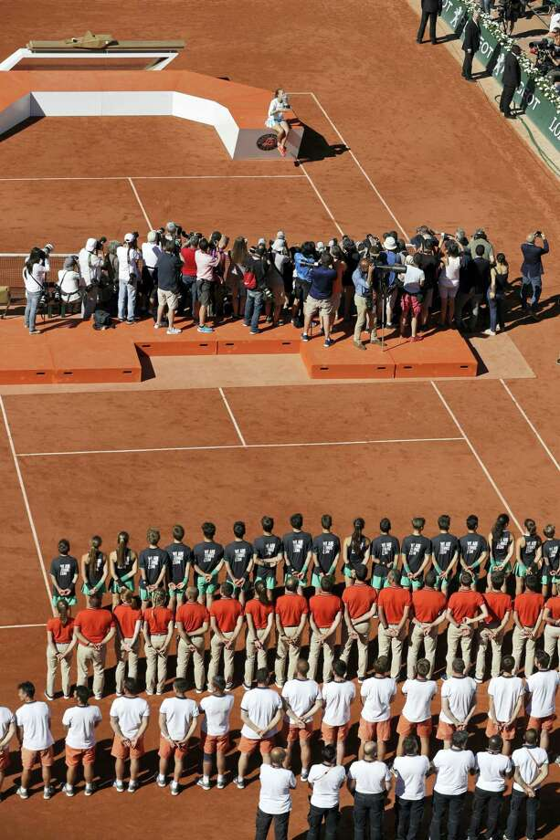 Latvia's Jelena Ostapenko, top, kisses the trophy during the award ceremony after winning the women's final match of the French Open tennis tournament against Romania's Simona Halep in three sets 4-6, 6-4, 6-3, at the Roland Garros stadium, in Paris, France, Saturday, June 10, 2017. Photo: AP Photo/Petr David Josek    / Copyright 2017 The Associated Press. All rights reserved.
