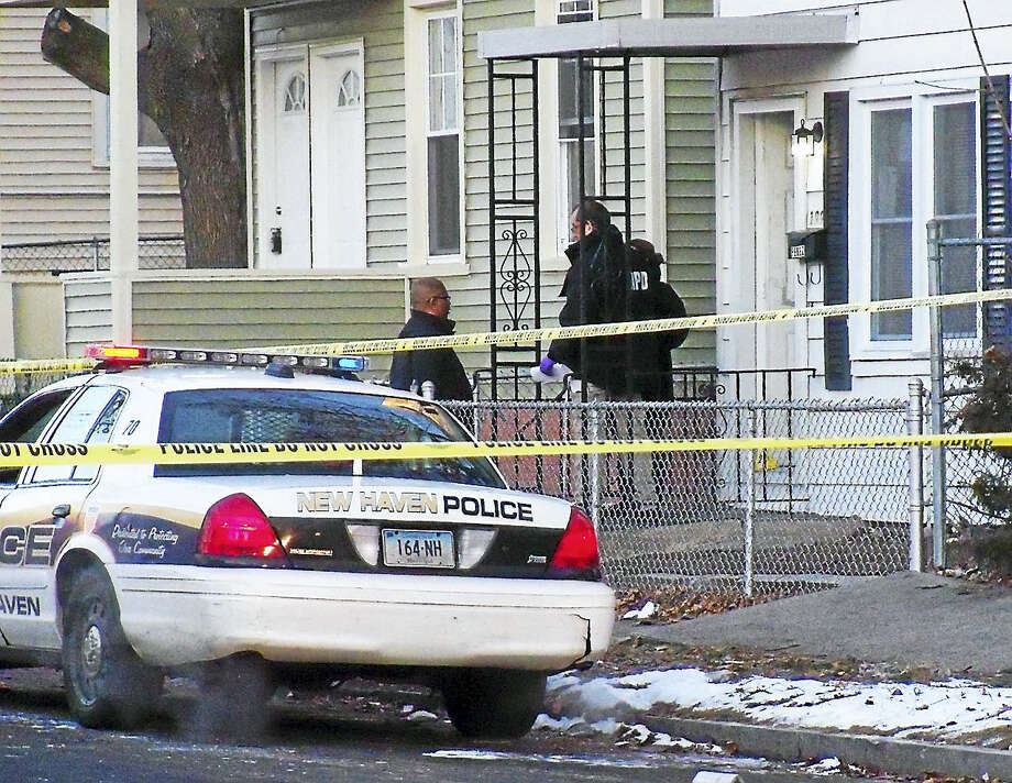 New Haven police were investigating Monday after a man was shot at a home at 199 Pine St. The homeowner reportedly told police the man had kicked in the door before the homeowner shot him. Photo: Wes Duplantier — New Haven Register