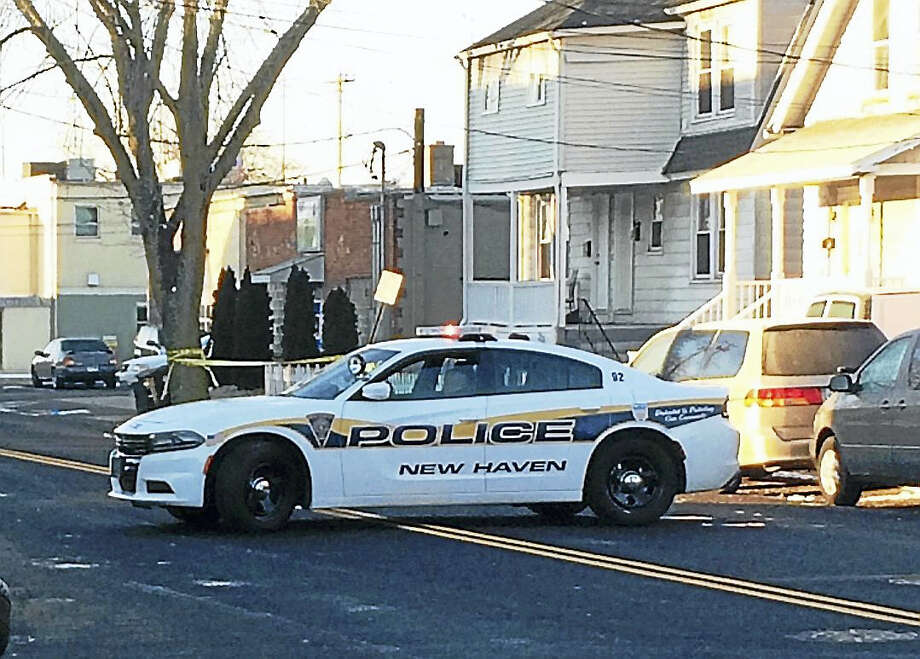 New Haven police were investigating after a man was critically hurt in a shooting early Monday morning. The man was found with several gunshot wounds in the driveway at 206 Fulton Terrace. Photo: Wes Duplantier — The New Haven Register