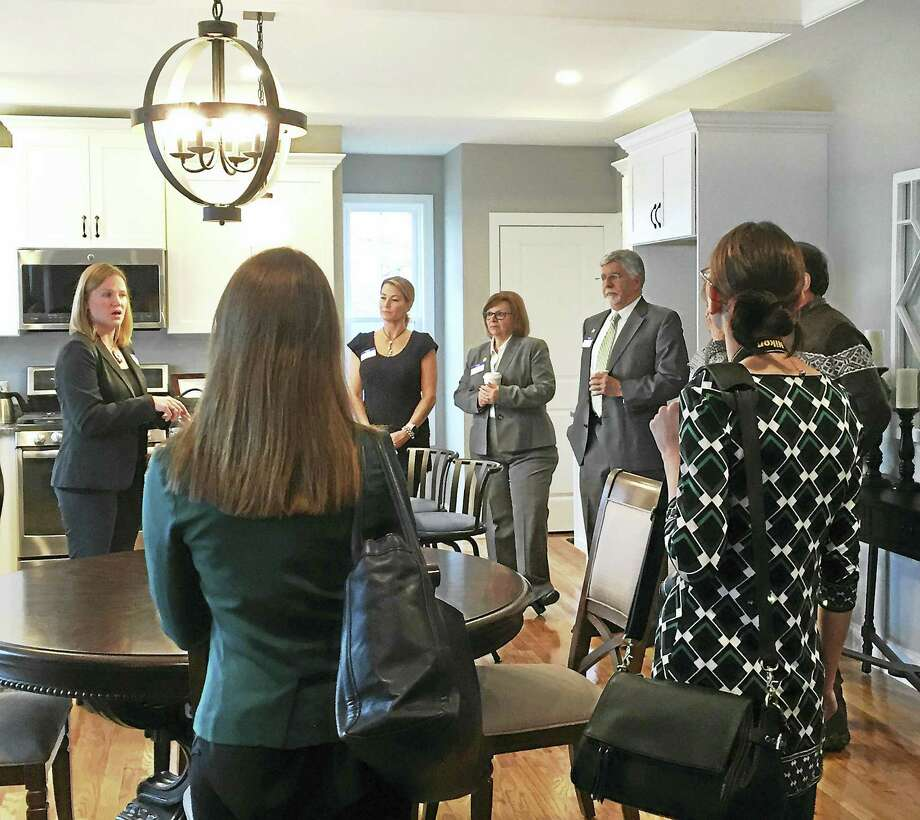 State and local lawmakers as well as representatives from Energize Connecticut, Home Builders and Remodelers Association and the Green Building Council were on hand to tour Connecticut's First Zero Energy subdivision, Singer Village in Derby. Photo: CONTRIBUTED PHOTO