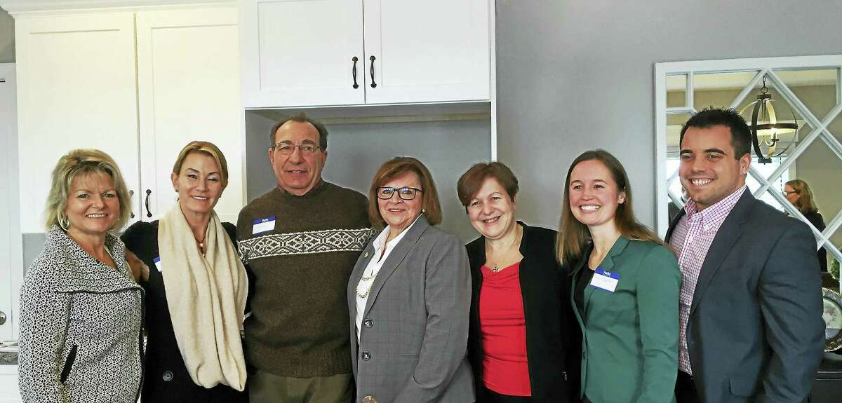 State and local lawmakers as well as representatives from Energize Connecticut, Home Builders and Remodelers Association and the Green Building Council were on hand to tour Connecticut's First Zero Energy subdivision, Singer Village in Derby.