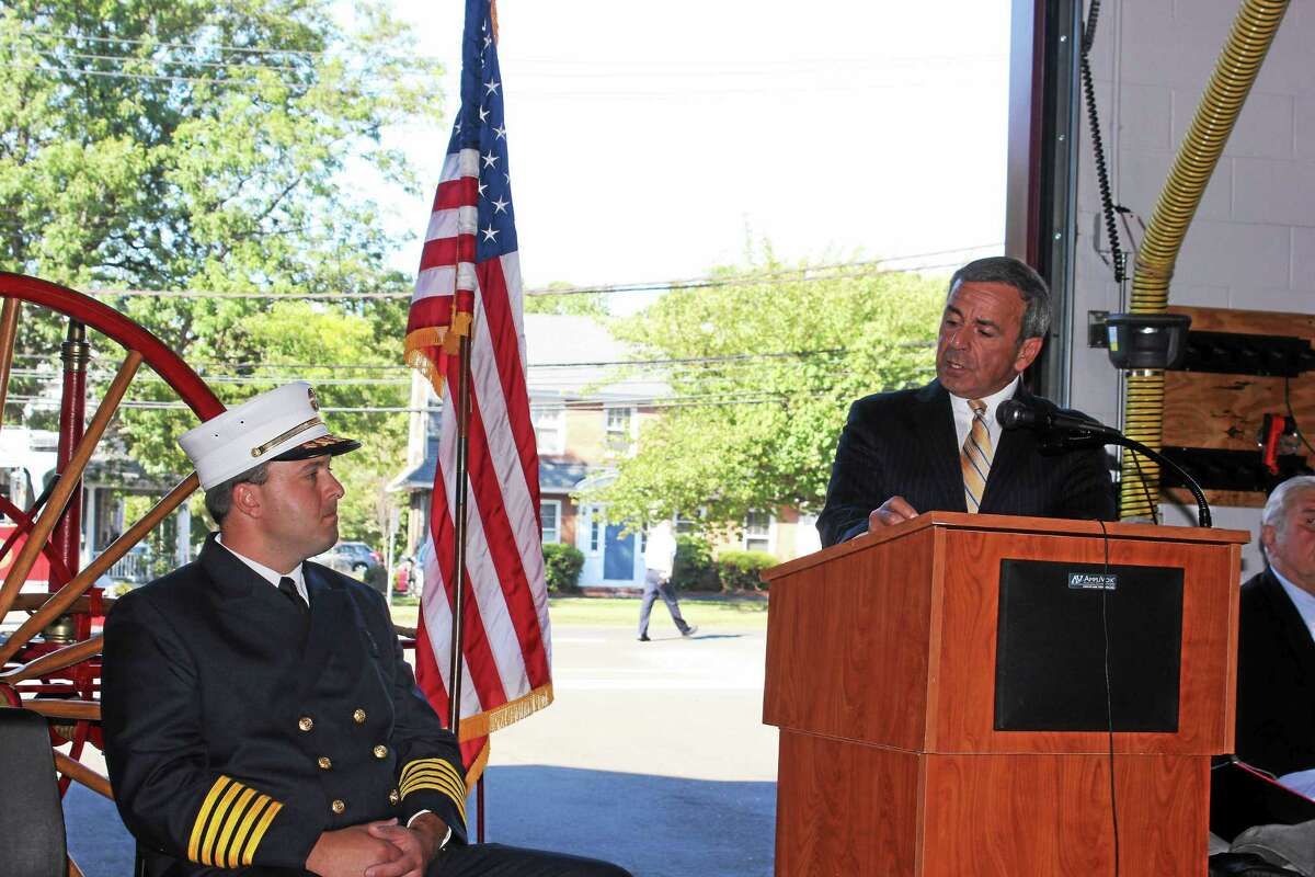 North Haven First Selectman Michael Freda, right, speaks at the swearing-in ceremony held at Fire Headquarters for Fire Chief Paul Januszewski, left.