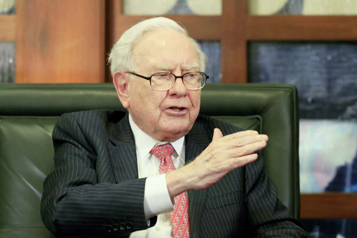 In a May 8 photo, Berkshire Hathaway Chairman and CEO Warren Buffett gestures during an interview by Liz Claman of the Fox Business Network in Omaha, Neb.