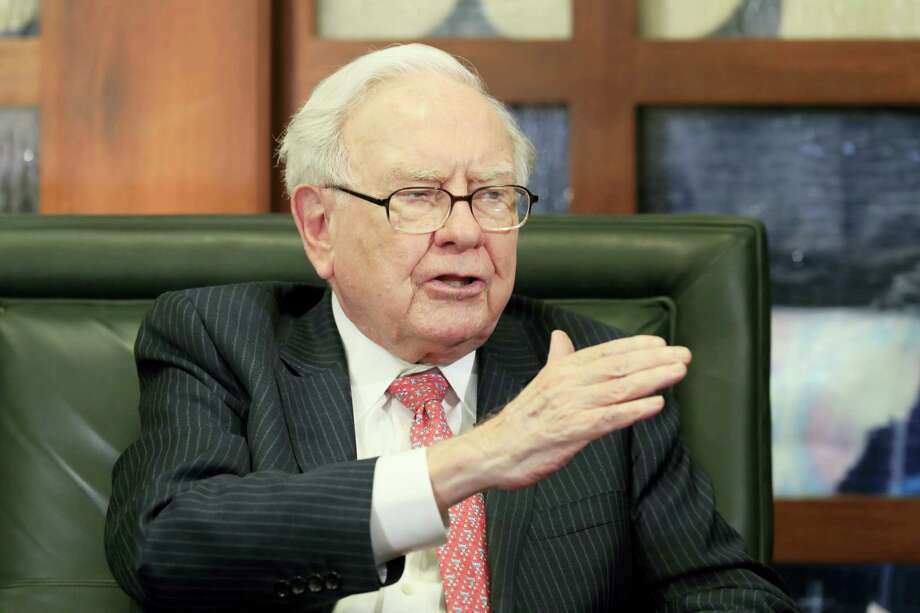 In a May 8 photo, Berkshire Hathaway Chairman and CEO Warren Buffett gestures during an interview by Liz Claman of the Fox Business Network in Omaha, Neb. Photo: Nati Harnik — The Associated Press File   / Copyright 2017 The Associated Press. All rights reserved.